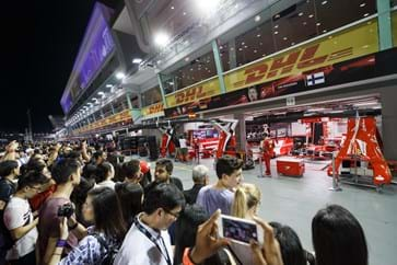 Guests get an exclusive close-up view of the team garages during the Pit Lane Walk-min.jpg