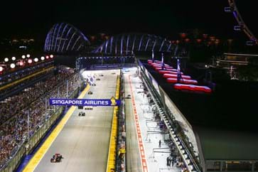 Thrilling race action as the cars head down the Pit Straight-min.jpg